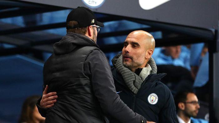 Pep Guardiola mengucapkan selamat atas keberhasilan Juergen Klopp menjuarai Liga Champions (Clive Brunskill/Getty Images)