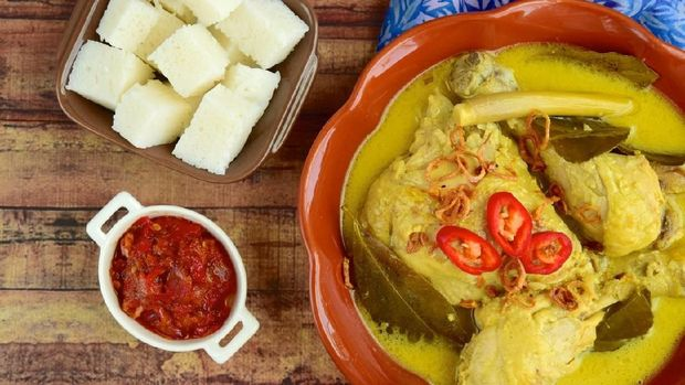 Opor ayam, chicken cooked in coconut milk from Central Java, Indonesia. Served with lontong and sambal. Popular dish for lebaran or Eid al-Fitr