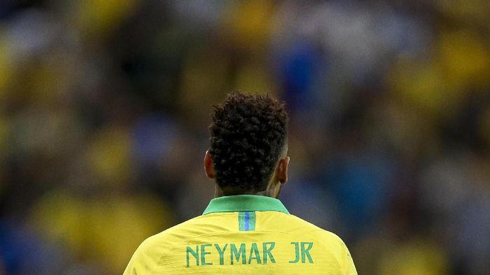 Neymar harus absen di Copa America 2019 akibat cedera pergelangan kaki di laga persahabatan melawan Qatar, Kamis (6/6/2019). (Foto: Buda Mendes/Getty Images)