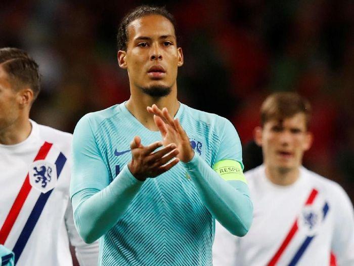 Virgil van Dijk diminta tampil lebih baik lagi saat di Timnas Belanda (REUTERS/Rafael Marchante)