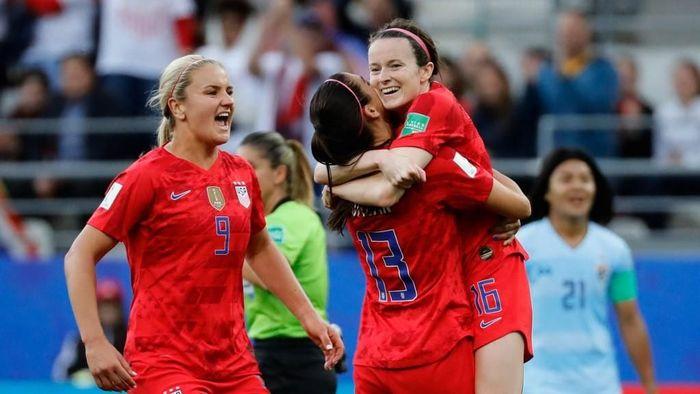 Timnas putri AS merayakan gol-gol ke gawang Thailand. (Thomas SAMSON / AFP)
