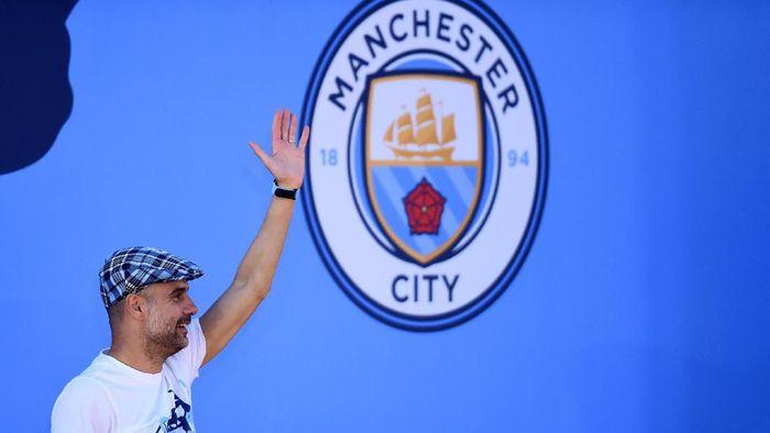 Pep Guardiola diklaim bakal istirahat melatih jika Man City juara Liga Champions (Nathan Stirk/Getty Images)