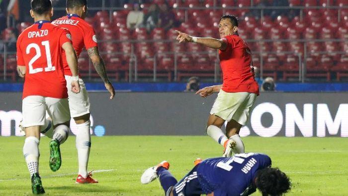 Chile lumat Jepang 4-0 di Copa America 2019. (Foto: Henry Romero/REUTERS)
