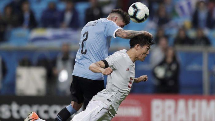 Meski Uruguay tersingkir di perempatfinal, Jose Gimenez menunjukkan penampilan solid di jantung pertahanan negaranya. Dia rata-rata membuat 2,3 tekel, 1,8 intersep dan 3,3 sapuan per laga. (REUTERS/Ueslei Marcelino)