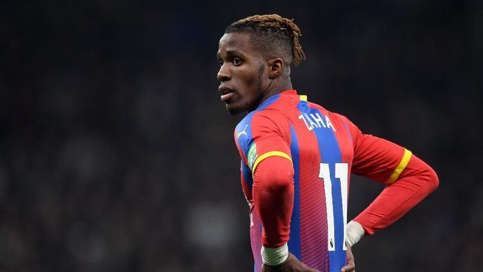 LONDON, ENGLAND - APRIL 03: Wilfried Zaha of Crystal Palace looks on during the Premier League match between Tottenham Hotspur and Crystal Palace at Tottenham Hotspur Stadium on April 03, 2019 in London, United Kingdom. (Photo by Michael Regan/Getty Images)