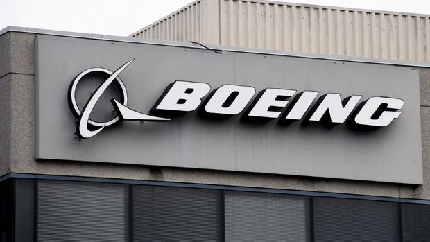 (FILES) In this file photo taken on March 11, 2019 The Boeing Company logo is seen on a building in Annapolis Junction, Maryland. - Boeing announced July 3, 2019it would give $100 million to communities and families affected by two crashes on its 737 MAX planes that claimed 346 lives. Describing the sum as an