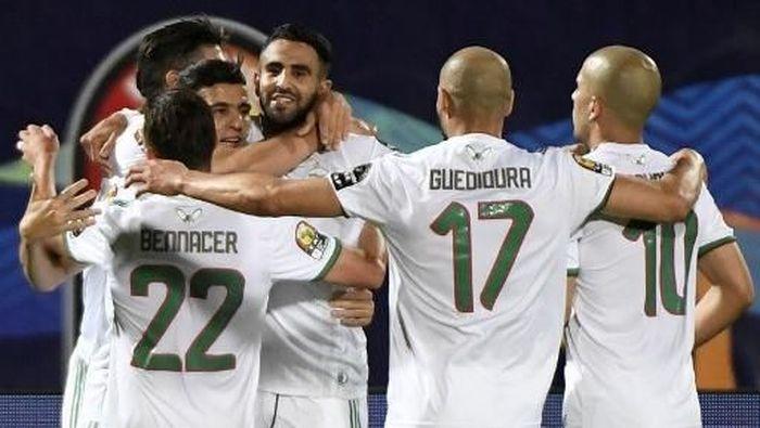 Timnas Aljazair melenggang ke perempatfinal Piala Afrika 2019. (Foto: Khaled DESOUKI / AFP)