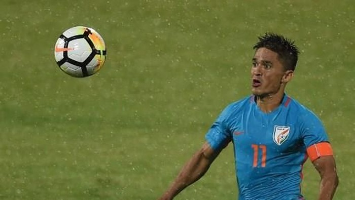 India captain Sunil Chhetri vies for the ball during the Hero Intercontinental Cup football match between India and Kenya in Mumbai on June 4, 2018. - Indias football international against Kenya on June 4  was sold out in hours following captain Sunil Chhetris emotional plea for fans to support the team after barely 2,500 people turned up to watch them play last week. (Photo by PUNIT PARANJPE / AFP)