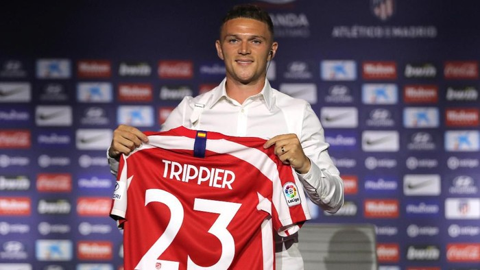 Soccer Football - Atletico Madrid unveil Kieran Trippier - Wanda Metropolitano, Madrid, Spain - July 18, 2019   Atletico Madrids new signing Kieran Trippier poses with a shirt during the unveling   REUTERS/Sergio Perez