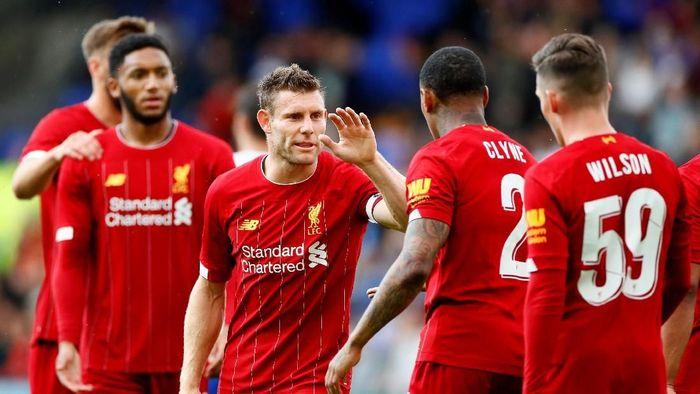 Pemain Liverpool, James Milner, sedang dalam usaha membiasakan diri memenangu trofi. (Foto: Jason Cairnduff/Reuters)