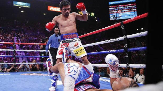 Manny Pacquiao, reacts after knocking down Keith Thurman in the first round during a welterweight title fight Saturday, July 20, 2019, in Las Vegas. (AP Photo/John Locher)