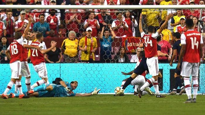 Real Madrid mengalahkan Arsenal lewat adu penalti di ICC 2019. (Foto: Jim Watson / AFP)