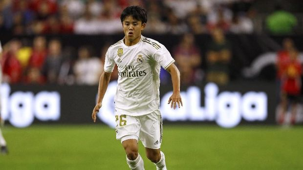 Real Madrid midfielder Takefusa Kubo dribbles the ball downfield against Bayern Munich during their International Champions Cup match on July 20, 2019 at NRG Stadium in Houston, Texas. (Photo by AARON M. SPRECHER / AFP)