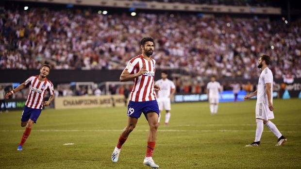 Atletico Madrid's forward Diego Costa celebrates his 2nd goal after scoring during the 2019 International Champions Cup football match between Real Madrid and Atletico Madrid at the Metlife Stadium Arena in East Rutherford, New Jersey on July 26, 2019. (Photo by Johannes EISELE / AFP)