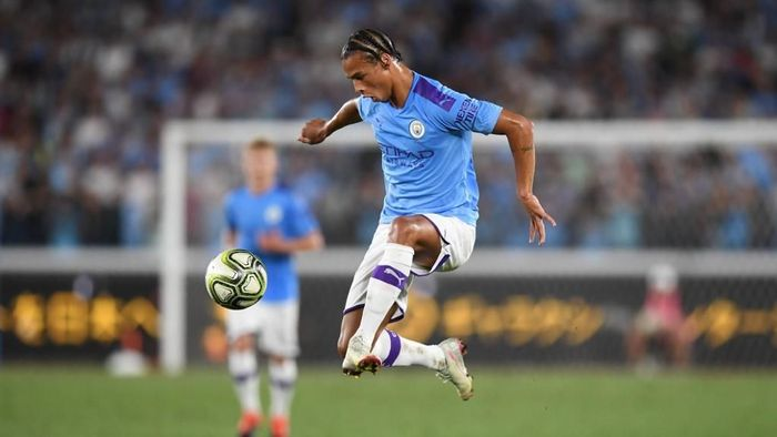Manchester Citys midfielder Leroy Sane controls the ball during a friendly football match between English Premier League club Manchester City and Japan League Yokohama F. Marinos at the Yokohama Stadium, in Yokohama on July 27, 2019. (Photo by CHARLY TRIBALLEAU / AFP)
