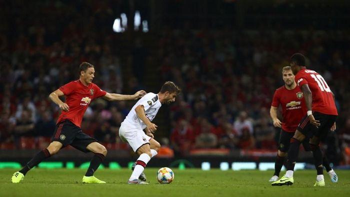 Man United mengalahkan AC Milan lewat adu penalti di ICC 2019. (Foto: Geoff Caddick / AFP)