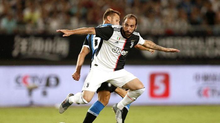 Gonzalo Higuain bisa saja pensiun di Juventus (Foto: Fred Lee/Getty Images)