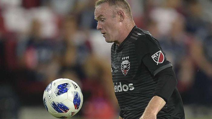 Wayne Rooney kedapatan masuk hotel bersama wanita misterius (ANDREW CABALLERO-REYNOLDS / AFP)