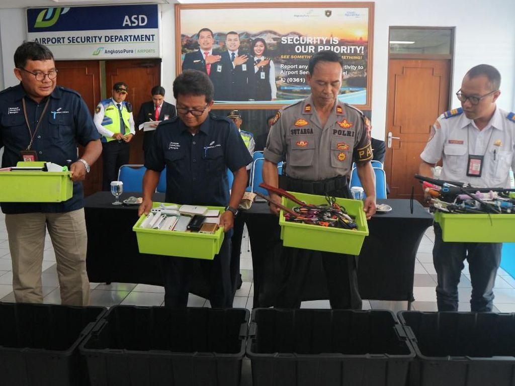AP I Musnahkan Ratusan Tongsis-Korek Api Sitaan dari Penumpang di Bali
