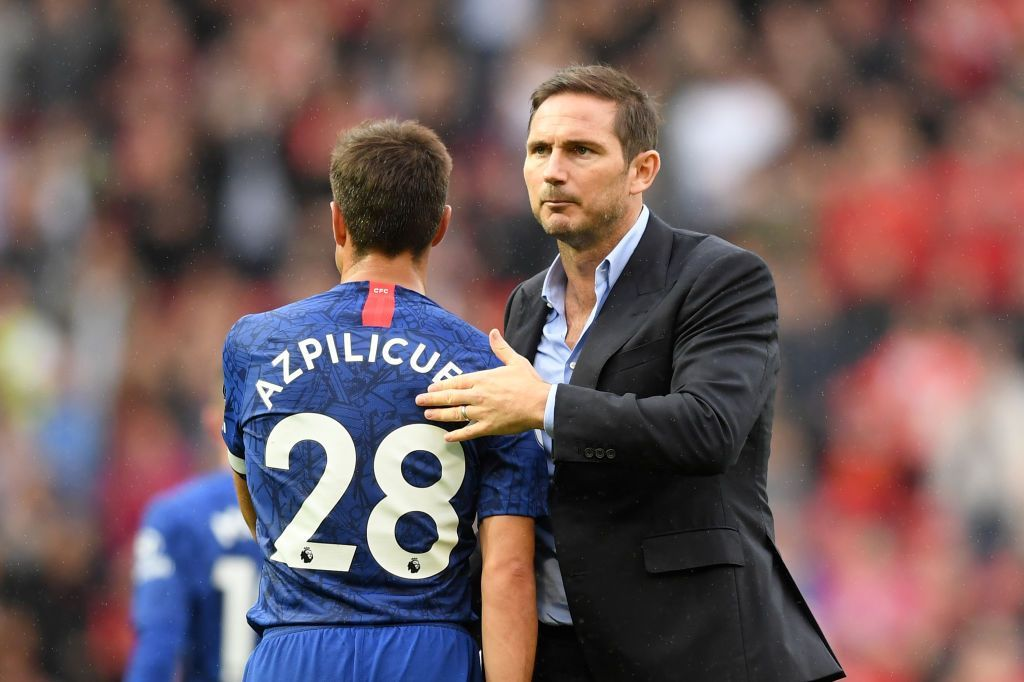 MANCHESTER, ENGLAND - AUGUST 11: Frank Lampard, Manager of Chelsea embraces Cesar Azpilicueta of Chelsea after the Premier League match between Manchester United and Chelsea FC at Old Trafford on August 11, 2019 in Manchester, United Kingdom. (Photo by Michael Regan/Getty Images)