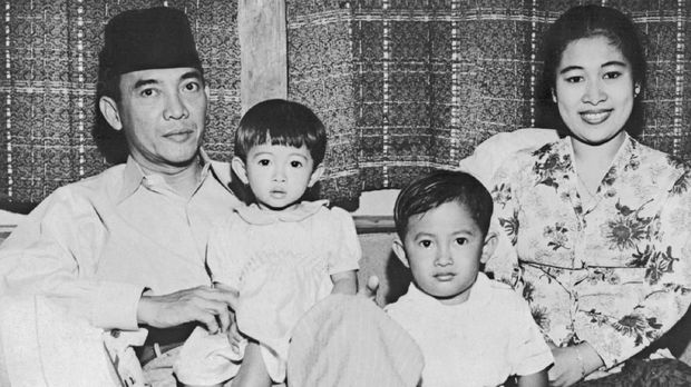Indonesian President Achmed Sukarno (1902-70) poses with his family, his wife, their son Guntur and daughter Megawati at their home shortly after he was elected president in 1945. Sukarno was Indonesia's first president (1945-66) when Indonesia was granted independence in 1945.  / AFP PHOTO