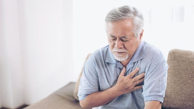 Senior male asian suffering from bad pain in his chest heart attack at home - senior heart disease