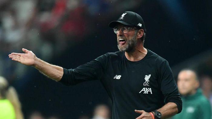 Juergen Klopp memuji perjuangan para pemain Liverpool untuk menundukkan Chelsea. (Foto: Michael Regan/Getty Images)