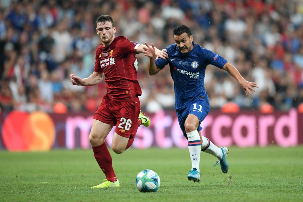 ISTANBUL, TURKEY - AUGUST 14: Pedro of Chelsea (R) challenges for the ball with Andy Robertson of Liverpool during the UEFA Super Cup match between Liverpool and Chelsea at Vodafone Park on August 14, 2019 in Istanbul, Turkey. (Photo by Michael Regan/Getty Images)