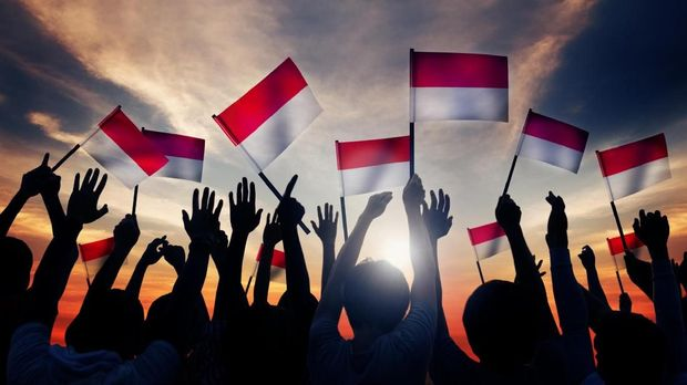 Group of People Waving the Flag of Indonesia