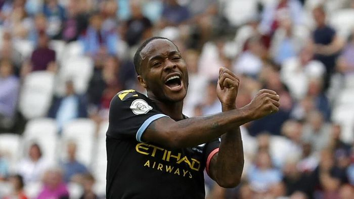 Manchester Citys Raheem Sterling celebrates after scoring his sides fifth goal during the English Premier League soccer match between West Ham United and Manchester City at London stadium in London, Saturday, Aug. 10, 2019. (AP Photo/Kirsty Wigglesworth)
