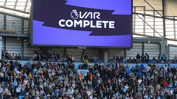 Fans wait while a possible goal by Manchester City's Gabriel Jesus is checked by VAR during the English Premier League soccer match between Manchester City and Tottenham Hotspur at Etihad stadium in Manchester, England, Saturday, Aug. 17, 2019. (AP Photo/Rui Vieira)