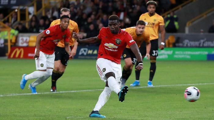 Eksekusi penalti Paul Pogba ke gawang Wolverhampton Wanderers gagal. (Foto: David Rogers/Getty Images)
