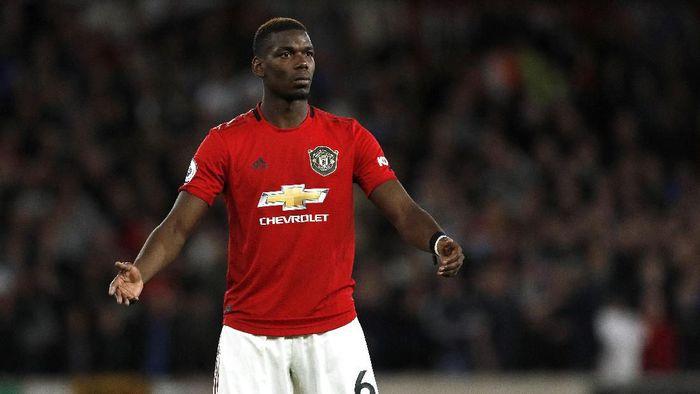 Paul Pogba kemungkinan absen tiga pekan dan melewatkan laga kontra Liverpool (Rui Vieira/AP Photo)