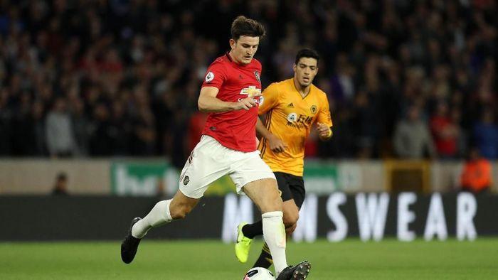 Harry Maguire dalam laga Wolverhampton vs MU (David Rogers/Getty Images)