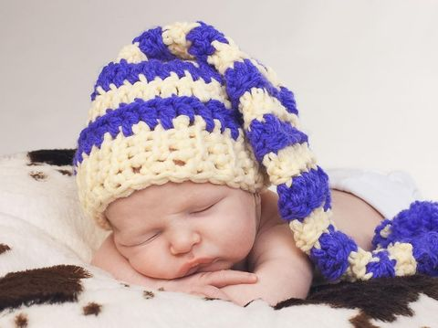 Sweet newborn baby boy in hat is sleeping