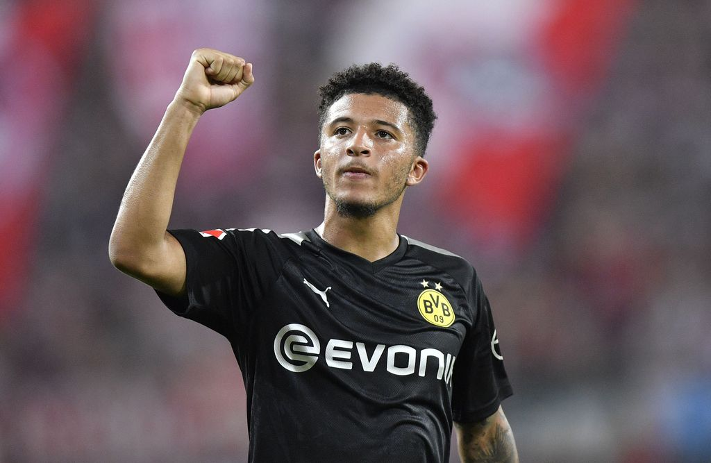 Dortmund's Jadon Sancho celebrates at the end of the German Bundesliga soccer match between FC Cologne and Borussia Dortmund in Cologne, Germany, Friday, Aug.23, 2019. Borussia won 3:1. (AP Photo/Martin Meissner)