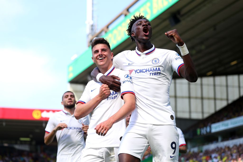 NORWICH, ENGLAND - AUGUST 24: Mason Mount and Tammy Abraham of Chelsea celebrates after scoring their team's second goal during the Premier League match between Norwich City and Chelsea FC at Carrow Road on August 24, 2019 in Norwich, United Kingdom. (Photo by Catherine Ivill/Getty Images)