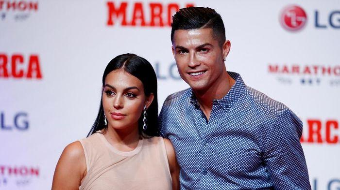 Cristiano Ronaldo dan Georgina Rodriguez. (Foto: Juan Medina / Reuters)