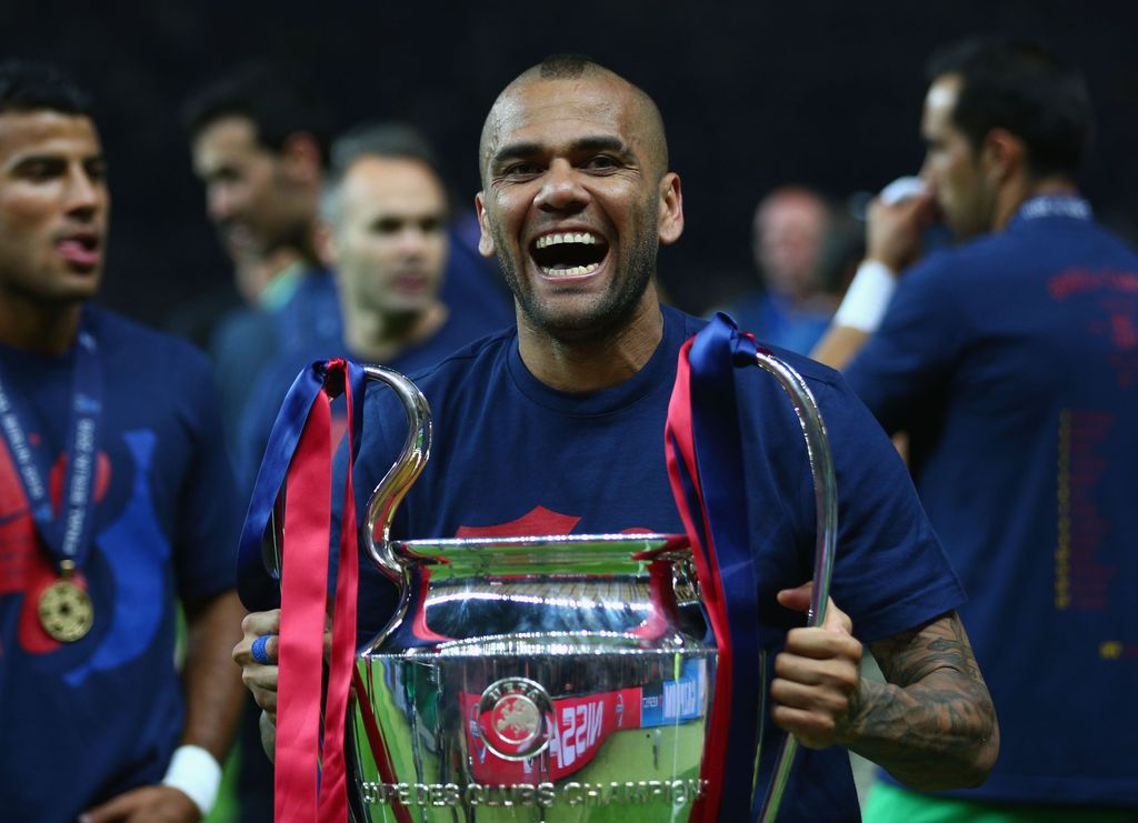 BERLIN, GERMANY - JUNE 06:  Daniel Alves of Barcelona celebrates with the trophy after the UEFA Champions League Final between Juventus and FC Barcelona at Olympiastadion on June 6, 2015 in Berlin, Germany.  (Photo by Paul Gilham/Getty Images)