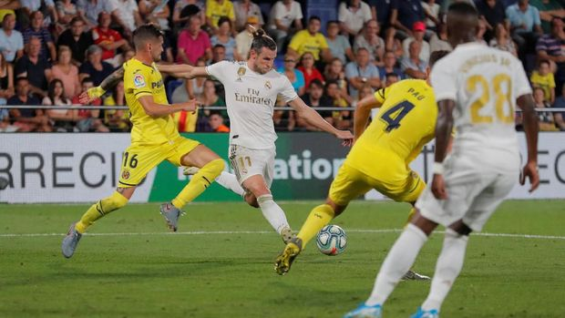 Soccer Football - La Liga Santander - Villarreal v Real Madrid - Estadio de la Ceramica, Villarreal, Spain - September 1, 2019   Real Madrid's Gareth Bale scores their second goal    REUTERS/Juan Medina