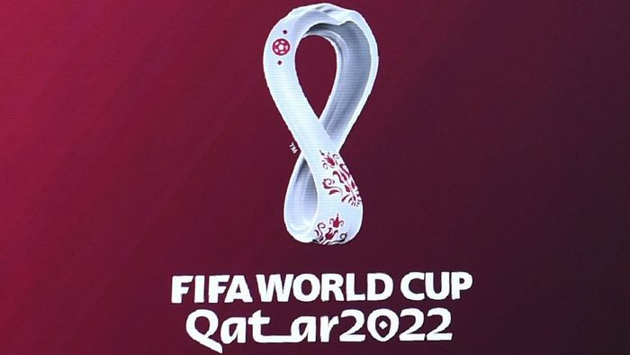 The official logo of the FIFA World Cup Qatar 2022 is unveiled on a giant screen in Madrid on September 3, 2019. (Photo by GABRIEL BOUYS / AFP)