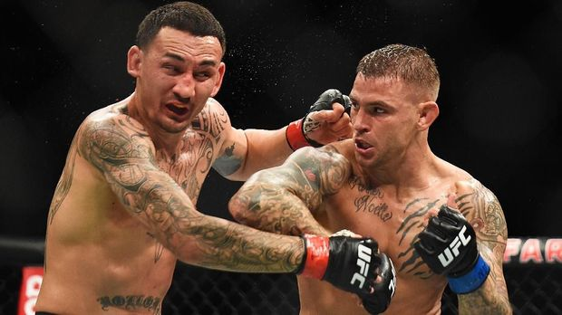 ATLANTA, GEORGIA - APRIL 13: Dustin Poirier punches Max Holloway during the UFC 236 event at State Farm Arena on April 13, 2019 in Atlanta, Georgia.   Logan Riely/Getty Images/AFP