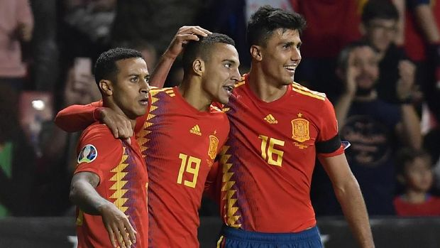 Spain's Rodrigo, centre, celebrates with Thiago Alcantara, left and Rodri Hernandez after scoring his side's second goal during the Euro 2020 group F qualifying soccer match between Spain and Faroe Islands at the Molinon, stadium in Gijon, Spain, Sunday, Sept. 8, 2019. (AP Photo/Alvaro Barrientos)