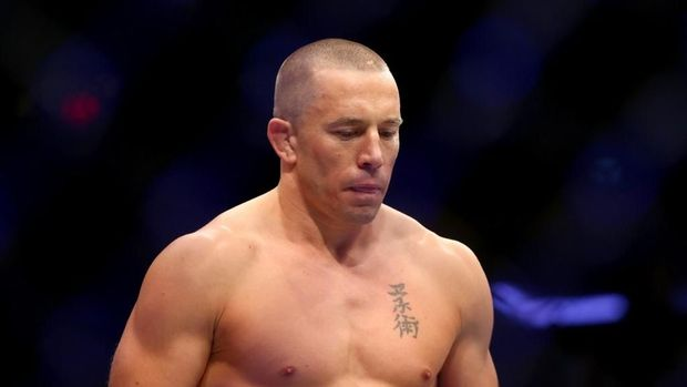 NEW YORK, NY - NOVEMBER 04: Georges St-Pierre of Canada enters the octagon for his UFC middleweight championship bout against Michael Bisping of England during the UFC 217 event at Madison Square Garden on November 4, 2017 in New York City.   Mike Stobe/Getty Images/AFP