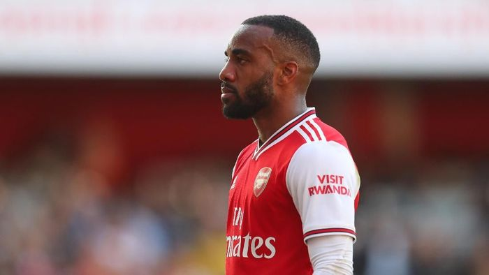 LONDON, ENGLAND - SEPTEMBER 01: Alexandre Lacazette of Arsenal celebrates after scoring his teams first goal during the Premier League match between Arsenal FC and Tottenham Hotspur at Emirates Stadium on September 01, 2019 in London, United Kingdom. (Photo by Catherine Ivill/Getty Images)