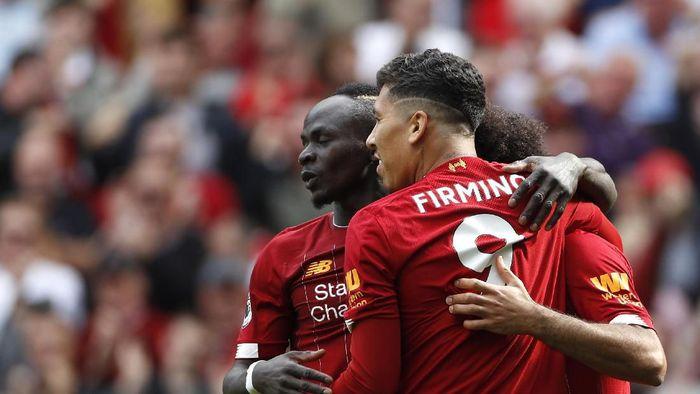 Roberto Firmino, Sadio Mane dan Mohamed Salah kerja sama ketiganya sangat mudah. (Foto: Rui Vieira/AP Photo)