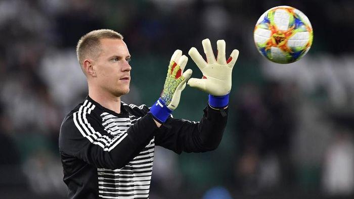 Bayern Ancam tak lepas pemainya ke timnas Jerman jika Ter Stegen gusur Neuer (Foto: John MACDOUGALL / AFP)