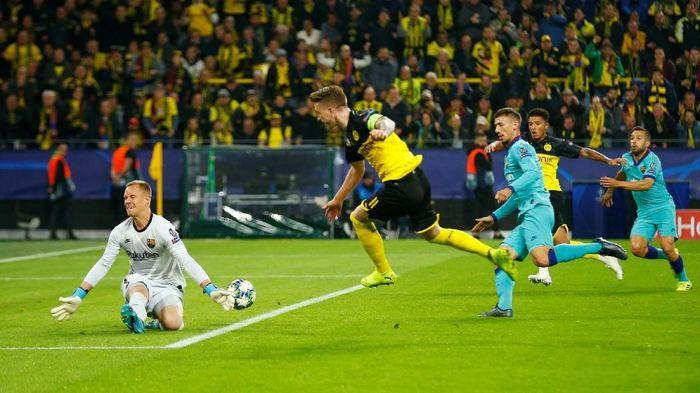 Broussia Dortmund vs Barcelona tuntas tanpa gol di babak pertama. (Foto: Thilo Schmuelgen/Reuters)