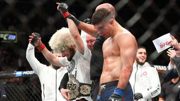 NEW YORK, NY - APRIL 07: Khabib Nurmagomedov (L) celebrates his win over Al Iaquinta (R) to capture the UFC lightweight championship at UFC 223 at Barclays Center on April 7, 2018 in New York City.   Ed Mulholland/Getty Images/AFP