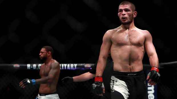 NEW YORK, NY - NOVEMBER 12: Khabib Nurmagomedov of Russia reacts against Michael Johnson of the United States in their lightweight bout during the UFC 205 event at Madison Square Garden on November 12, 2016 in New York City.   Michael Reaves/Getty Images /AFP